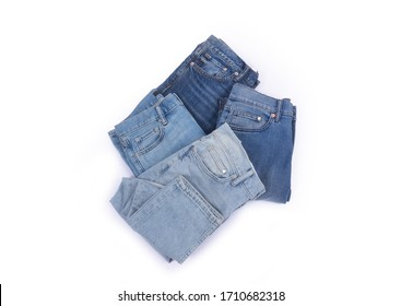 folded four Blue Denim jeans trouser isolated over white background-back view