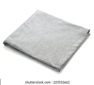 Folded grey cotton napkin isolated on white background