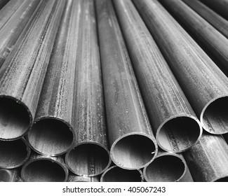 Folded industrial grey plastic tubes background