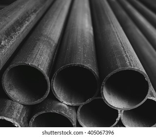 Folded industrial plastic tubes closeup background