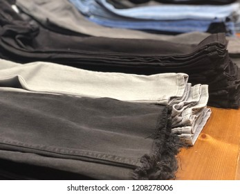 folded jeans on a store shelf