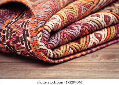 A folded kilim rug  with shallow depth of field