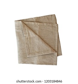 Folded linen napkin isolated over a white background with clipping path included. Image shot from overhead.