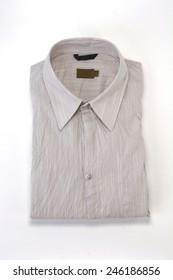 folded linen shirt on white