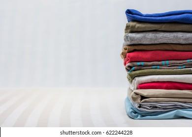 Folded men's clothing on stripy background