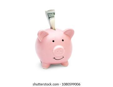 Folded money in piggy bank on white background.