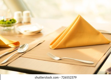 folded napkin on the set-up table in the restaurant