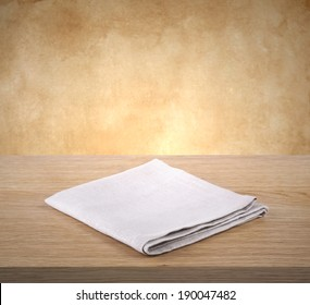 Folded napkin on wooden table