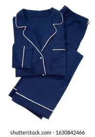 Folded navy blue pajama set on white background