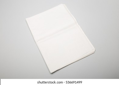 Folded newspapers on gray background