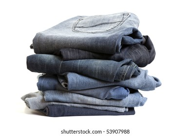 Folded Old Blue Jeans on isolated white background