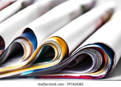 Folded old magazines, selective focus