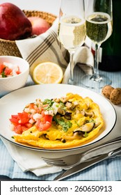 Folded Omelette with Mushroom, Tomato and Onion Salsa, Served with sparking wine