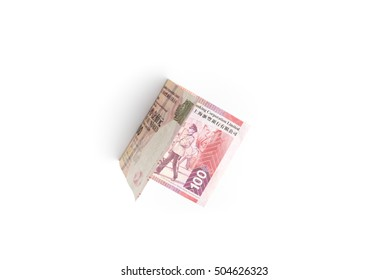 Folded one hundred 100 Hong Kong dollars or HKD banknote isolated on white background, currency of Hong Kong