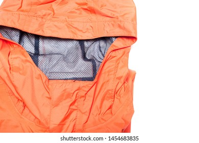 Folded orange zipper windbreaker jacket, rain proof and waterproof hiking Gore-Tex jacket hoodie. Track jacket sport nylon full zip isolated on white. Folded clothes. Outer layer garment for travel.