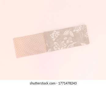 Folded piece of fabric ready to sew, isolated tailor tools on light background