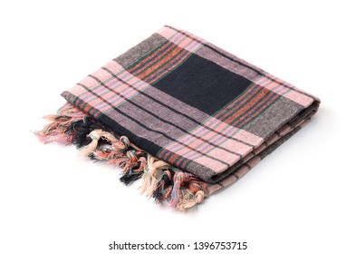 Folded plaid cloth with tassels isolated on white