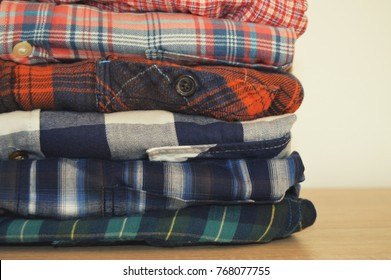 Folded plaid shirts, flannel shirts