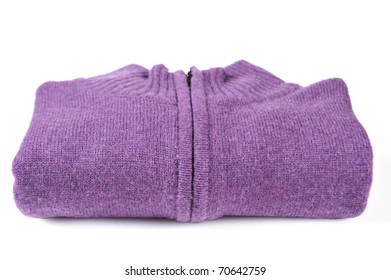 Folded purple sweater isolated on white