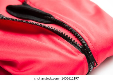 Folded red zipper windbreaker jacket, UV sun proof outdoor jacket hoodie. Track jacket sport hoodie full zip isolated on white background. Folded clothes.