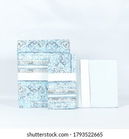 A folded set of decorative abstract bedlinens on a white background