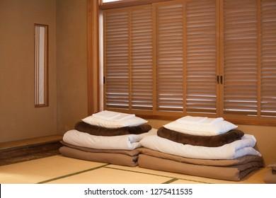 Folded sheets in Japanese Ryokan hotel bedroom