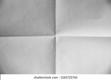 Folded sheets of white paper, isolated on white and black background