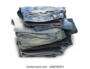 Folded stack of blue jeans isolated on white background