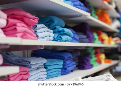 Folded tshirts in a shop