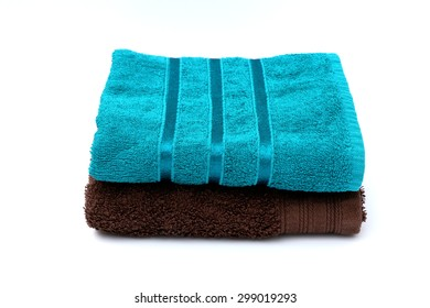 Folded Turquoise and Brown Towel