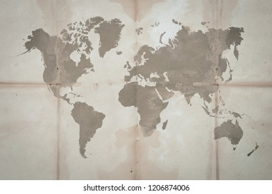 Folded Vintage Map of the world on Crumpled paper texture