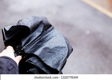 Folded wet umbrella