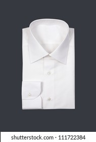 Folded white man shirt on gray background
