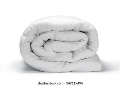 Folded white quilt