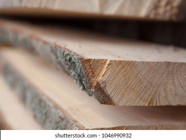 Folded wooden planks in a sawmill. Piled boards as texture