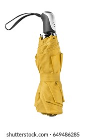Folded yellow automatic umbrella on white background