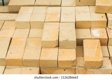 Folded yellow bricks in the building store
