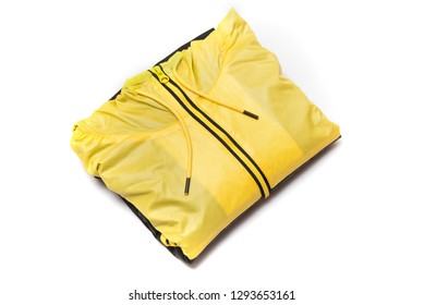 Folded yellow zipper windbreaker jacket, rain proof jacket hoodie. Track jacket sport shiny nylon full zip isolated on white. Folded clothes.