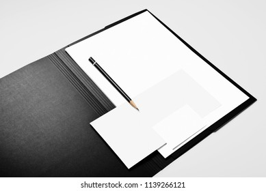 Folder, blank sheets of paper, pencil, and business card