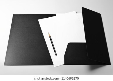 Folder, blank sheets of paper and pencil