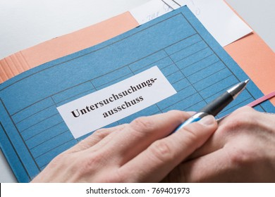 Folder with files and inscription in german words - Committee of Inquiry