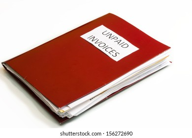 Folder full of business papers: bills, accounts receivable,invoices,receipts,etc. Blue folder with a business paperwork and red tape.