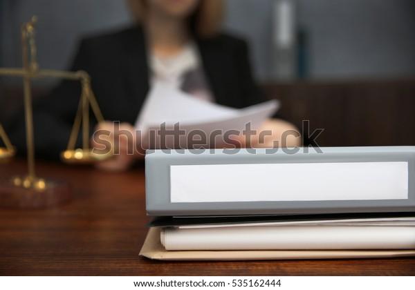 Folder on lawyer table, closeup