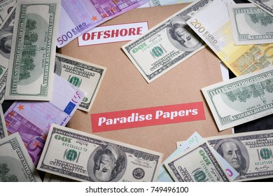 Folder with Paradise papers label on it with european and american currency, offshore tax heaven documents leak concept