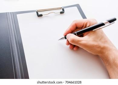 folder, pen, male hand, background