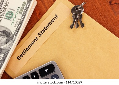 folder with the settlement statement on wooden background close-up