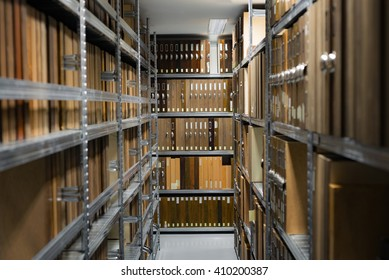 Folder storage room details in metal shelves wooden brown cases with police evidence