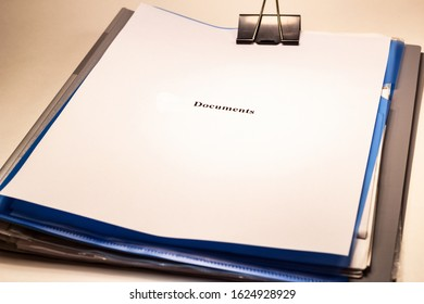 Folders with papers on which a sheet of paper with the word documents