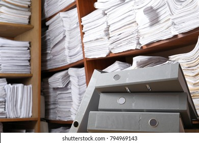 Folders and shelves with old paper documents in archive