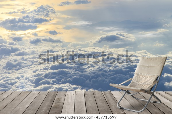 Enjoyable Folding Chair On Wooden Balcony Terrace Stock Photo Edit Squirreltailoven Fun Painted Chair Ideas Images Squirreltailovenorg